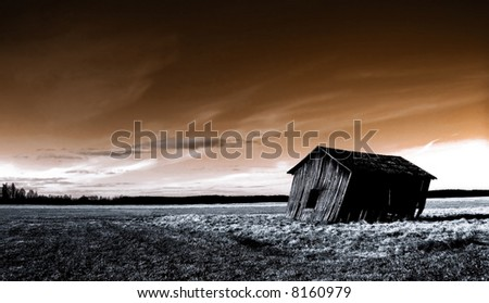 deserted haunted house on a empty field - stock photo