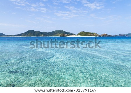 Deserted Japanese tropical islands with clear blue water of a coral lagoon, Kerama Islands National Park, Okinawa - stock photo