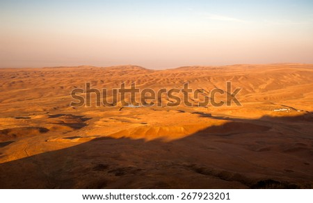 deserted landscape Asian arid territory with the sunrise - stock photo