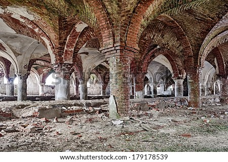 Deserted medieval church basement, with brick arches - stock photo