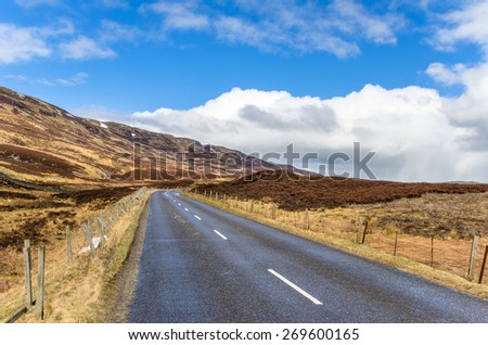 Deserted Narrow Road in the Highlands of Scotland - stock photo