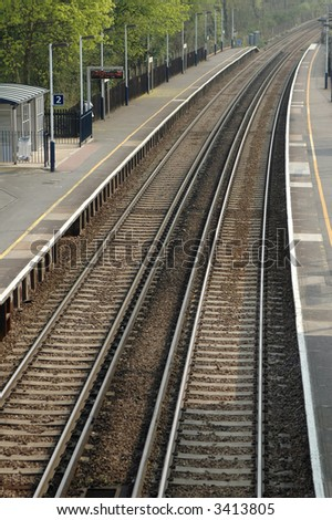 deserted railroad platform and curved track; second of three views - stock photo