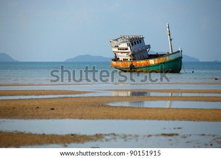 Deserted ship on the sea, Koh Mak, Trat, Thailand. - stock photo