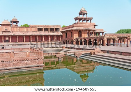 deserted town fatehpur sikri reflecting in the pond - india - rajasthan - agra - stock photo