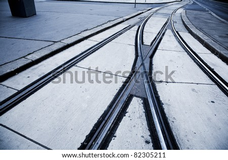 Deserted Viennese street with nice tram rails early in the morning. - stock photo