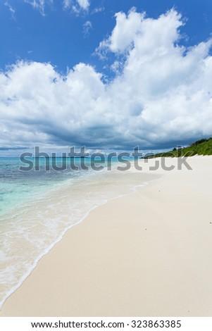 Deserted white sand tropical beach of Japan, Miyako Island, Okinawa - stock photo