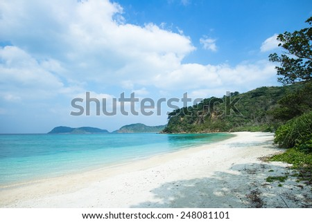 Deserted white sand tropical beach with clear blue water, Iriomote Island National Park of the Yaeyama Islands, Okinawa, Japan - stock photo