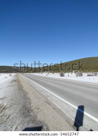 Deserted winter road in wide mountain valley  near Leadville, Colorado