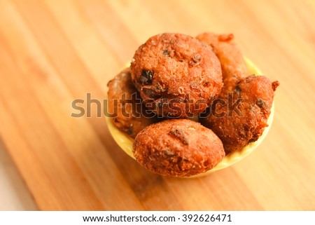 Desi Indian snack tikki/cutlet kept on wooden spoon, selective focus, food concept - stock photo