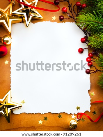 Design a Christmas greeting card with white paper on a red background - stock photo