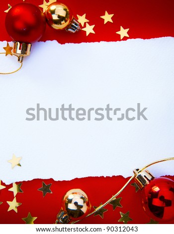 Design a Christmas greeting with a paper on a red background - stock photo