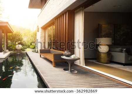 design and deco of rest place near entrance of house with sunbeam - stock photo