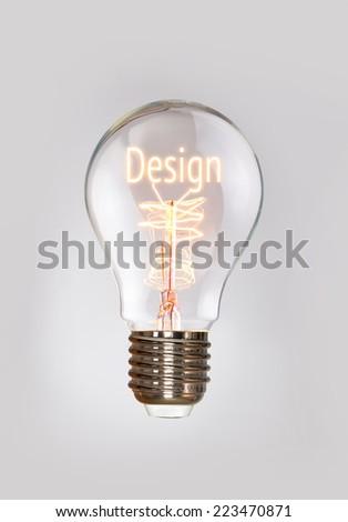 Design concept in a filament lightbulb. - stock photo