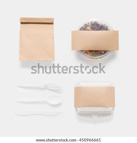 Design concept of mockup salad, bag and container box set isolated on white background. Copy space for text and logo. Clipping Path included on white background. - stock photo