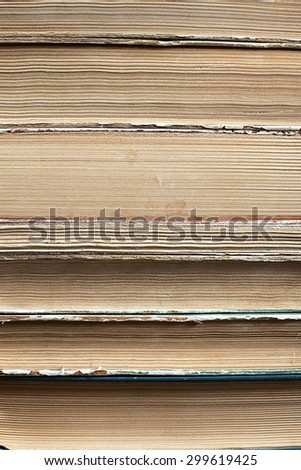 Design concept of wisdom and knowledge power - close up view on stacked old books placed under day light - stock photo