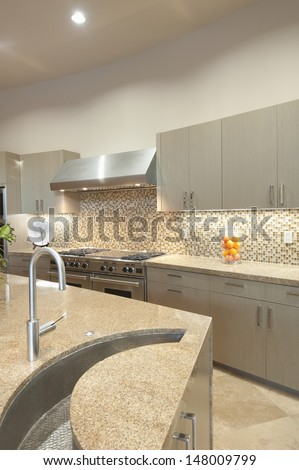 Design detail sink in kitchen with stainless steel fitted units - stock photo
