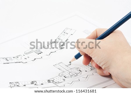 Design drawings and a hand drawing a project by pencil on paper - stock photo