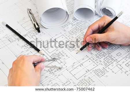 Design drawings and human hands drawing a project by pencil on paper - stock photo