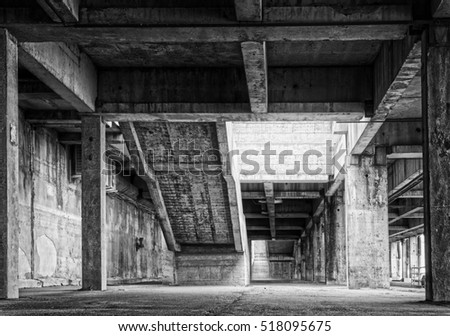 design element. abandoned industrial hangar interior black and white HDR image