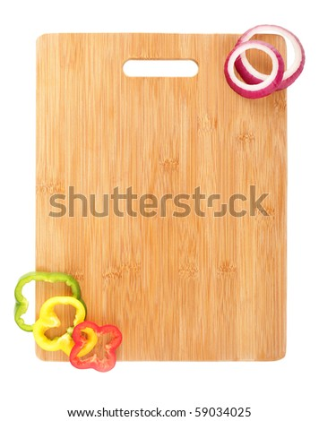 Design element of a clean, new cutting board and vegetable slices - stock photo