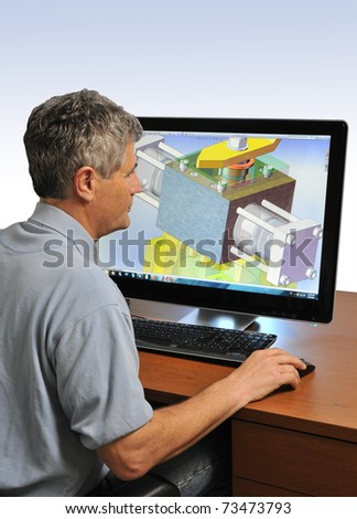 Design Engineer at Work on a Computer - stock photo