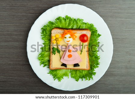design food. Creative sandwich for a child with a picture little man - stock photo