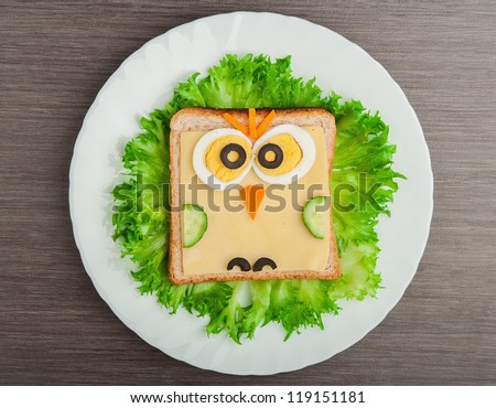 design food. Creative sandwich for a child with a picture little  owl - stock photo
