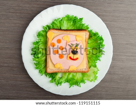 design food. Creative sandwich for a child with a picture little  puppy, doggy