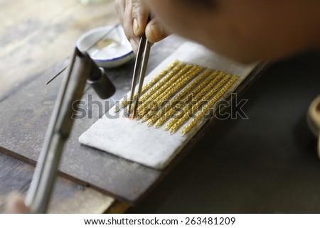 design gold necklaces - stock photo