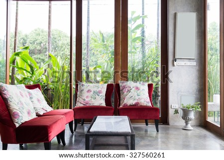 design of interior living room modern style with red sofa furniture in green garden - stock photo