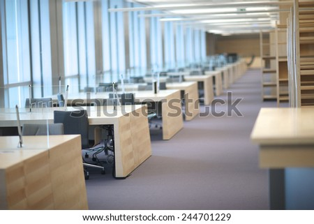 Design of new department office; row of empty tables - stock photo