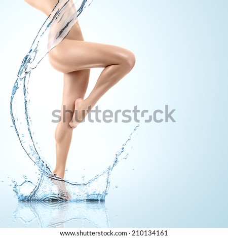 Design of young woman body with clean water splash - stock photo