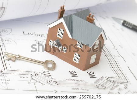 Design plans for a new home on drawing plans - stock photo