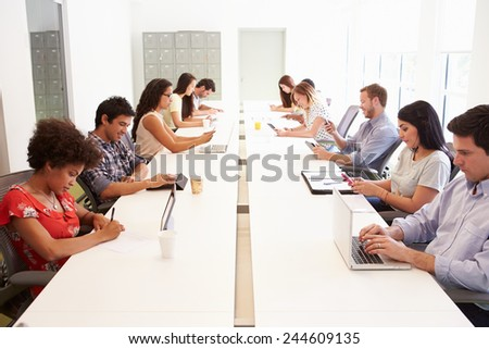 Design Team Collaborating On Project Together - stock photo