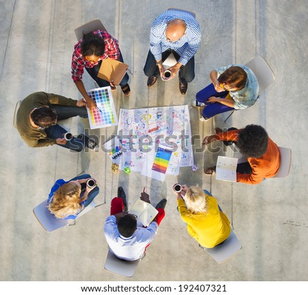 Design Team Planning on a Project with Color Swatches - stock photo