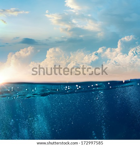 design template with underwater part and cloudy sky splitted by waterline - stock photo