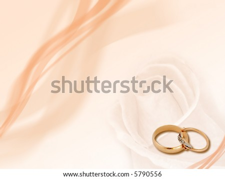 Design: two wedding golden rings on smooth background. - stock photo