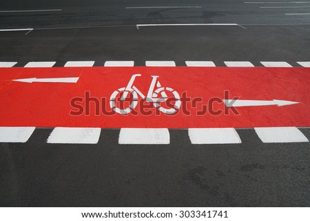 designated cycleway bike lane painted vibrant red - stock photo