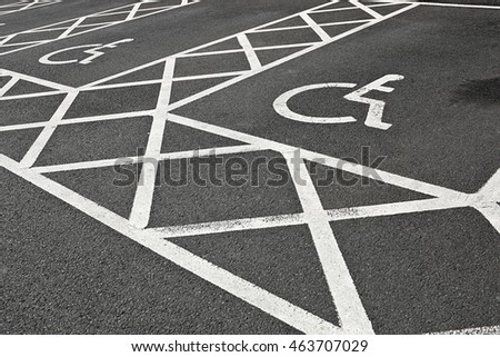 Designated Disabled car parking spaces reserved with white painted lines often set aside to give handicapped people accessibility in a car park.