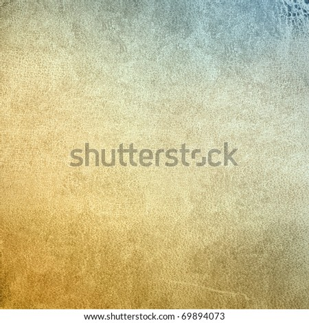 Designed background for your text - detailed closeup of blank grungy mottled and scratched leather texture with applied color - stock photo