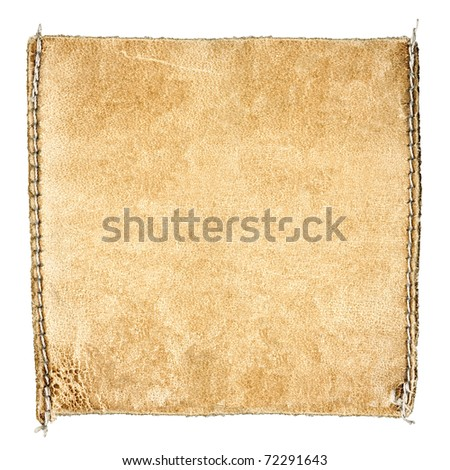 Designed background for your text - detailed closeup of blank grungy scratched leather label on blue denim, square - stock photo