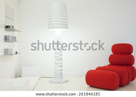 Designed couch and lamp in contemporary interior - stock photo
