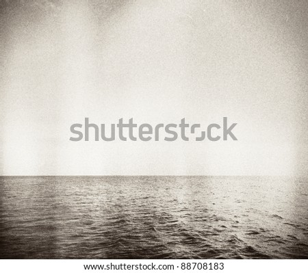 Designed retro photo. Abstract seascape. Grain, dust added as vintage effect. - stock photo