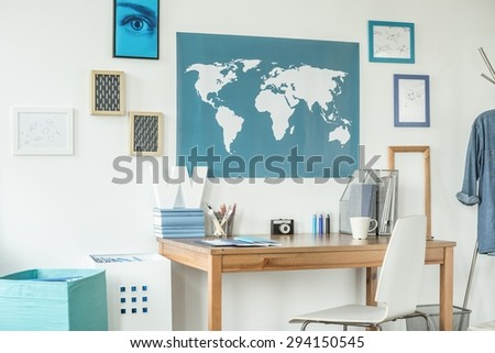 Designed workspace with world map in teen room