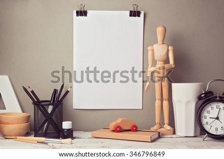 Designer artistic desk website header hero image with blank poster mock up - stock photo