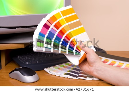 Designer at work. Color samples on table. - stock photo