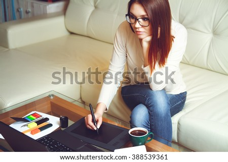 Designer at work with a cup of coffee. Telework concept - stock photo