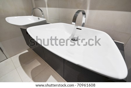 designer bathroom detail with double hand wash basin - stock photo