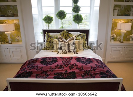 Designer bedroom with contemporary furniture and decor. - stock photo