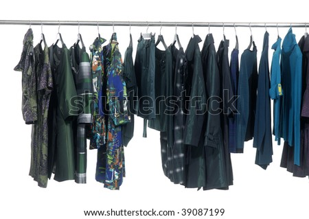 Designer clothes lined up hangers - stock photo